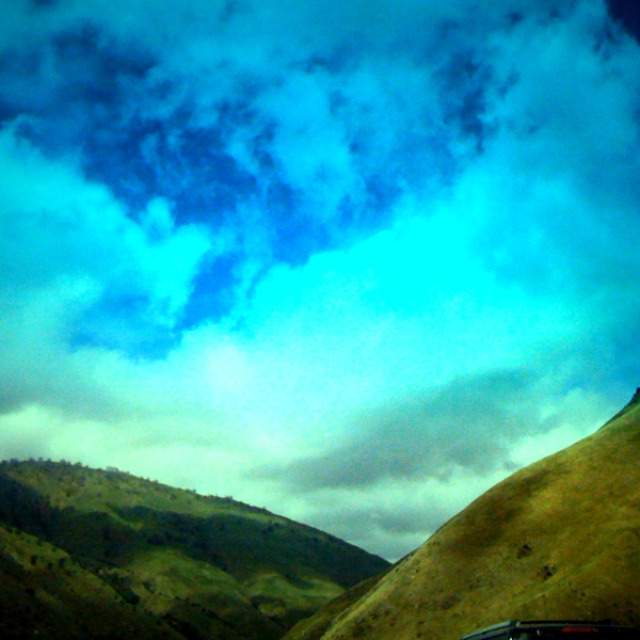 hills and clouds, driving the grapevine out of LA, two hills,